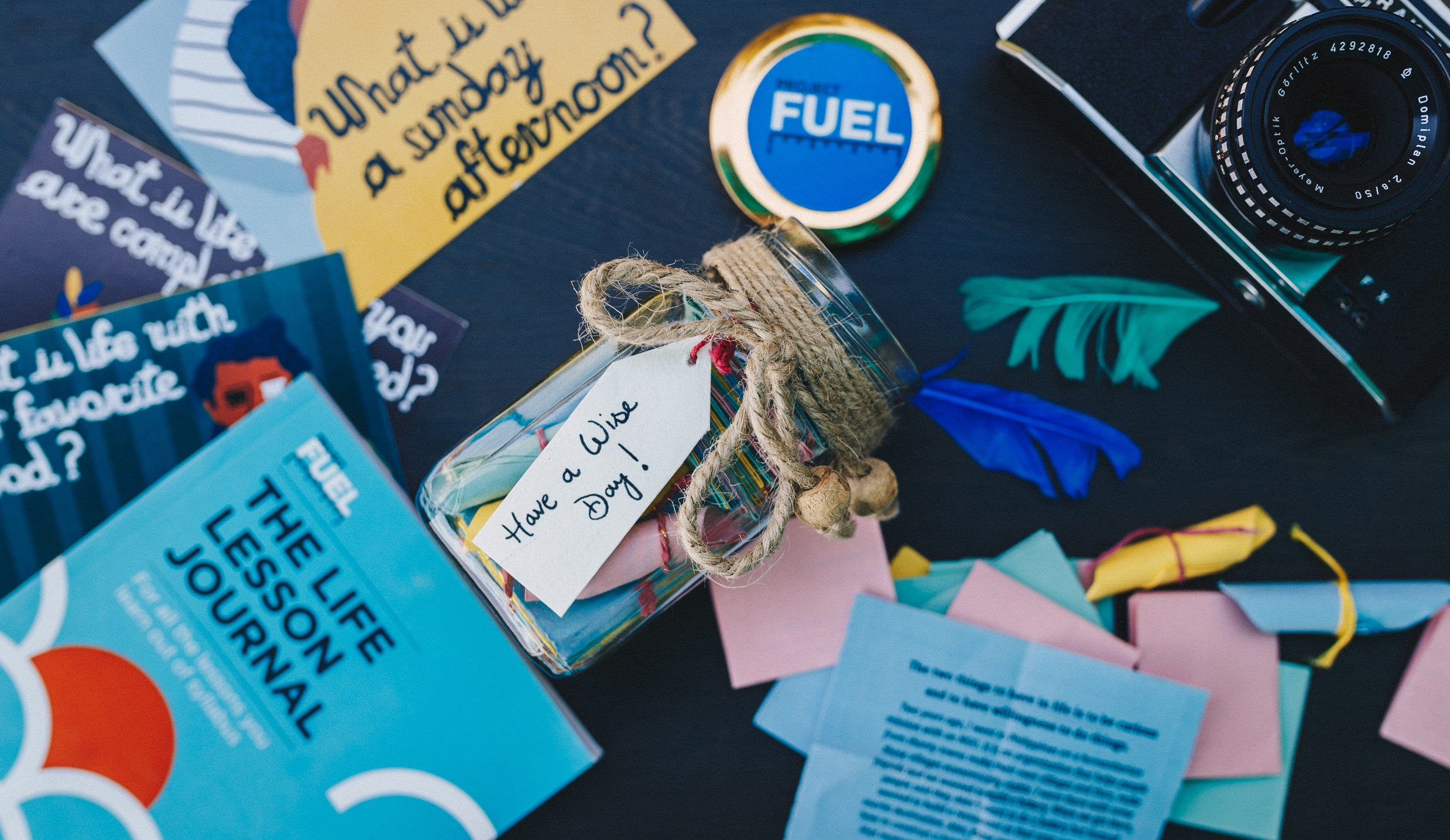 Project FUEL, Life Lessons Jar, The Life Lesson Journal (For Adults), The Life Lesson Journal (For Students), What is lIfe? Postcards, Wisdom pins, FUEL Wisfom Manifesto